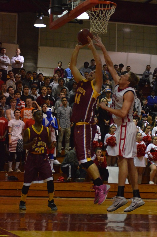 Greenwich center Alex Wolf goes up for a block against St. Joseph's Steve Hashemi Tuesday night. (Photo: Lauren Price)