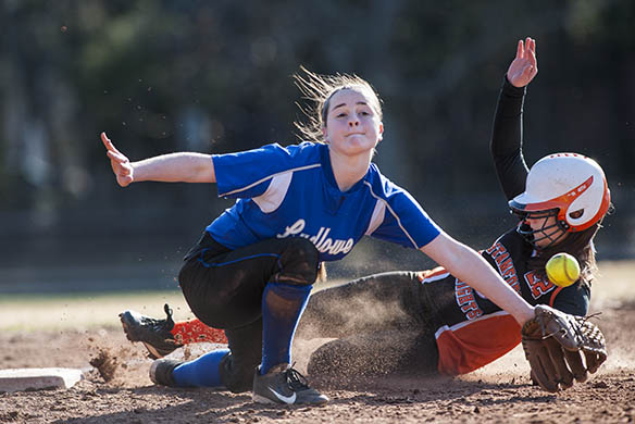 Stamford's Nicole Pease slides safely into second base as Ludlowe's Alice Nelson reaches for the throw. (Photo: Mark Conrad)