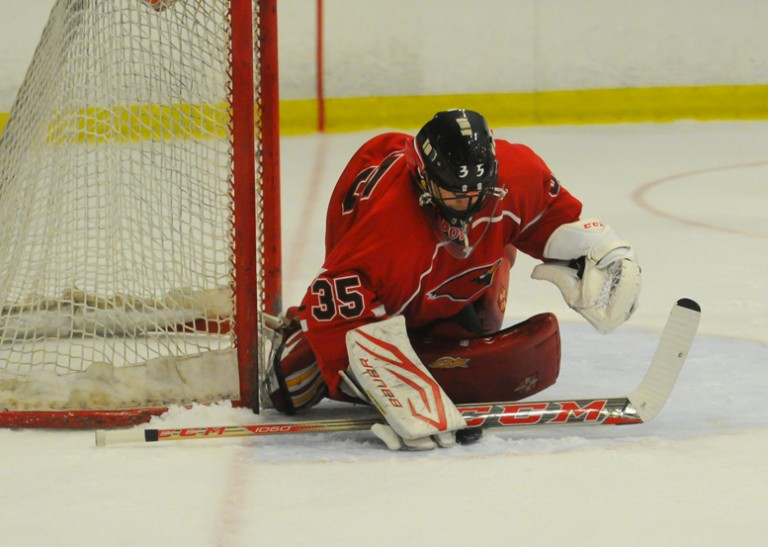 Greenwich goaltender Nick Bozzuto makes one of his 32 saves. (Photo: Gregory Vasil)